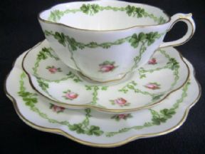 Stunning George Jones tea trio Lucky clover and roses